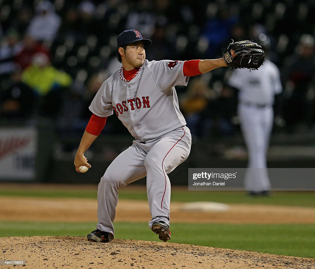 <a gi-track='captionPersonalityLinkClicked' href=/galleries/search?phrase=Junichi+Tazawa&family=editorial&specificpeople=4624306 ng-click='$event.stopPropagation()'>Junichi Tazawa</a> #36 of the Boston Red Sox pitches in the 8th inning against the Chicago White Sox at U.S. Cellular Field on April 16, 2014 in Chicago, Illinois. The Red Sox defeated the White Sox 6-4 in 14 innings.