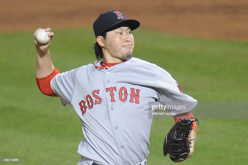 Junichi Tazawa #36 of the Boston Red Sox pitches in the eighth inning during a baseball game against the Baltimore Orioles on June 10, 2014 at Oriole Park at Camden Yards in Baltimore, Maryland. The Red Sox won 1-0.