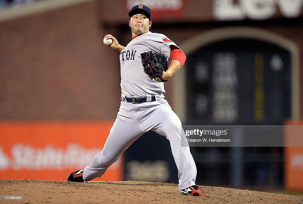 <a gi-track='captionPersonalityLinkClicked' href=/galleries/search?phrase=Junichi+Tazawa&family=editorial&specificpeople=4624306 ng-click='$event.stopPropagation()'>Junichi Tazawa</a> #36 of the Boston Red Sox pitches in the eighth inning against the San Francisco Giants at AT&T Park on August 20, 2013 in San Francisco, California.