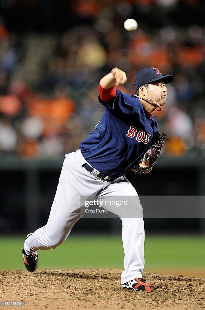 <a gi-track='captionPersonalityLinkClicked' href=/galleries/search?phrase=Junichi+Tazawa&family=editorial&specificpeople=4624306 ng-click='$event.stopPropagation()'>Junichi Tazawa</a> #36 of the Boston Red Sox pitches in the eighth inning against the Baltimore Orioles at Oriole Park at Camden Yards on September 28, 2013 in Baltimore, Maryland.