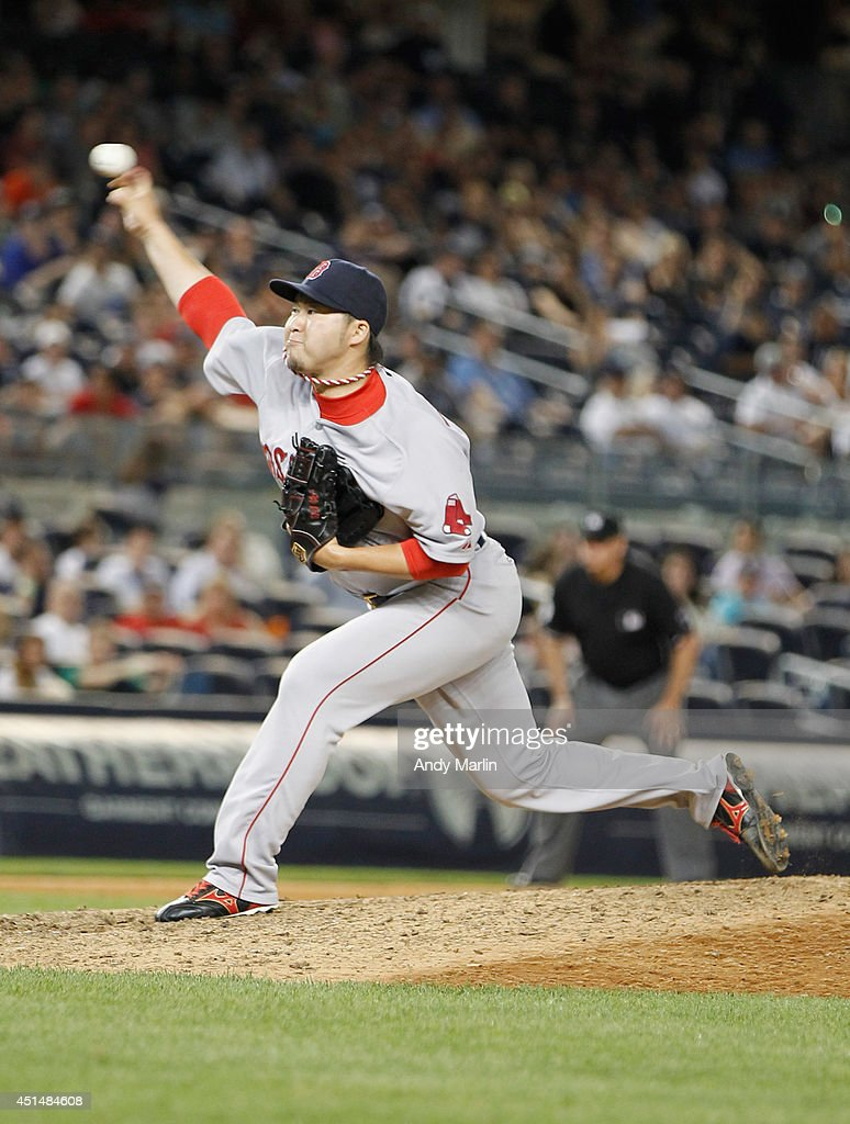 Junichi Tazawa #36 of the Boston Red Sox pitches in the eighth inning against the New York Yankees at Yankee Stadium on June 29, 2014 in the Bronx borough of New York City. The Red Sox defeated the Yankees 8-5.