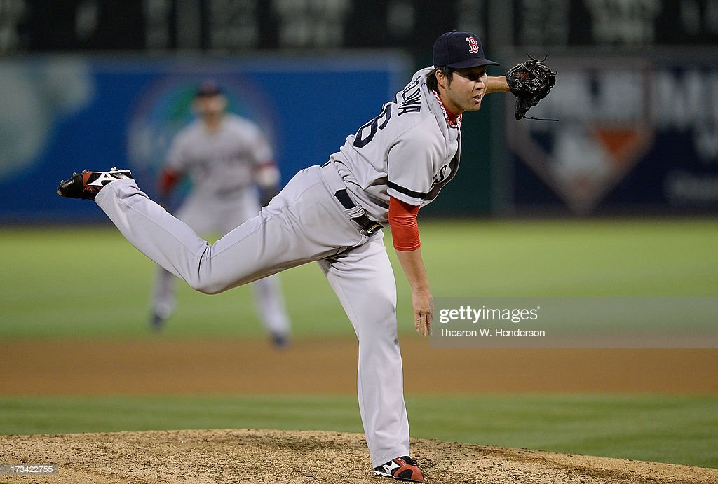 <a gi-track='captionPersonalityLinkClicked' href=/galleries/search?phrase=Junichi+Tazawa&family=editorial&specificpeople=4624306 ng-click='$event.stopPropagation()'>Junichi Tazawa</a> #36 of the Boston Red Sox pitches in the seventh inning against the Oakland Athletics at O.co Coliseum on July 13, 2013 in Oakland, California.