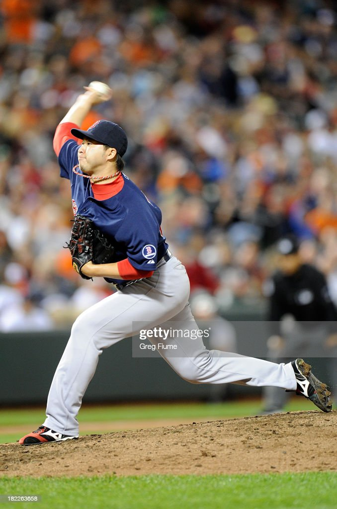 <a gi-track='captionPersonalityLinkClicked' href=/galleries/search?phrase=Junichi+Tazawa&family=editorial&specificpeople=4624306 ng-click='$event.stopPropagation()'>Junichi Tazawa</a> #36 of the Boston Red Sox pitches in the seventh inning against the Baltimore Orioles at Oriole Park at Camden Yards on September 28, 2013 in Baltimore, Maryland.