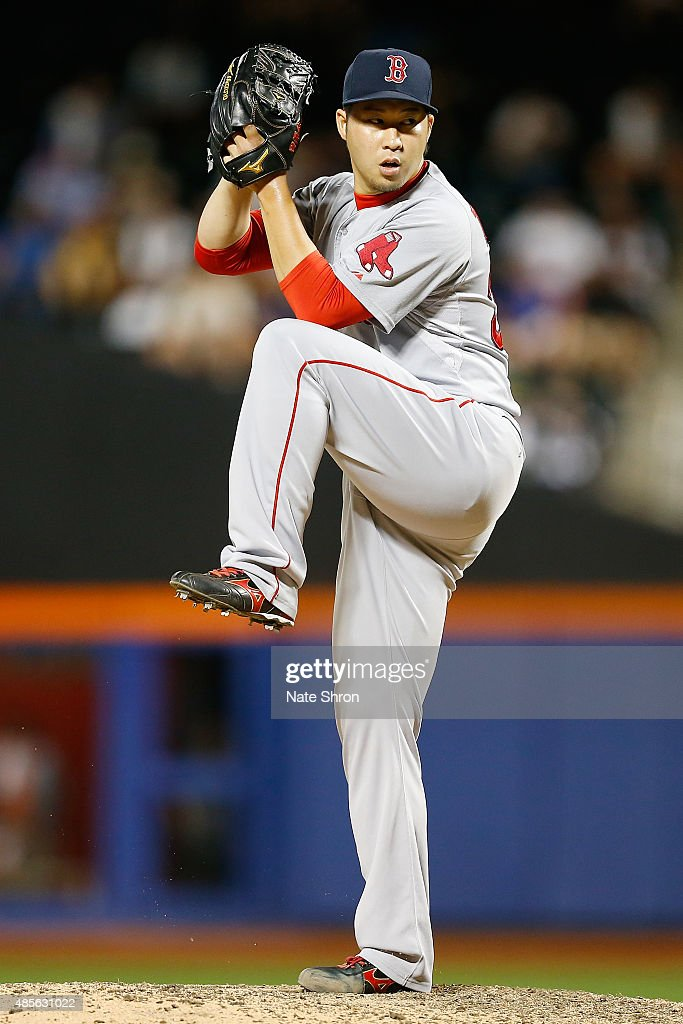 Junichi Tazawa #36 of the Boston Red Sox pitches in the tenth inning against the New York Mets on August 28, 2015 at Citi Field in the Flushing Neighborhood of the Queens borough of New York City.