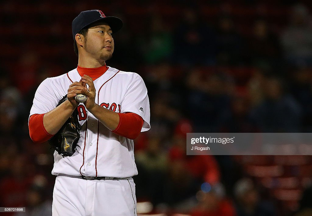 Junichi Tazawa #36 of the Boston Red Sox prepares to face a batter during the ninth inning against the New York Yankees at Fenway Park on April 30, 2016 in Boston, Massachusetts.