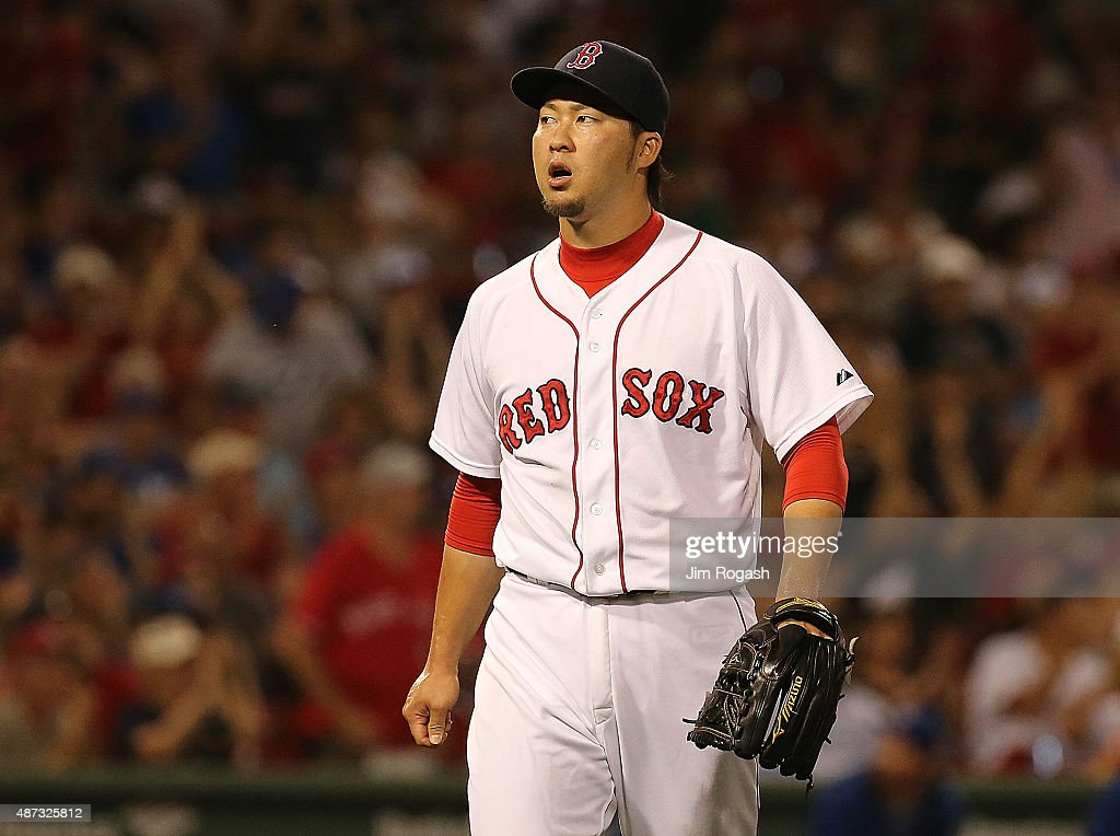 <a gi-track='captionPersonalityLinkClicked' href=/galleries/search?phrase=Junichi+Tazawa&family=editorial&specificpeople=4624306 ng-click='$event.stopPropagation()'>Junichi Tazawa</a> #36 of the Boston Red Sox reacts after a scoreless eighth inning against the Toronto Blue Jay at Fenway Park on September 8, 2015 in Boston, Massachusetts.