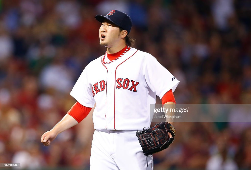 <a gi-track='captionPersonalityLinkClicked' href=/galleries/search?phrase=Junichi+Tazawa&family=editorial&specificpeople=4624306 ng-click='$event.stopPropagation()'>Junichi Tazawa</a> #36 of the Boston Red Sox reacts after closing out the 8th inning against the Minnesota Twins during the game at Fenway Park on June 17, 2014 in Boston, Massachusetts.