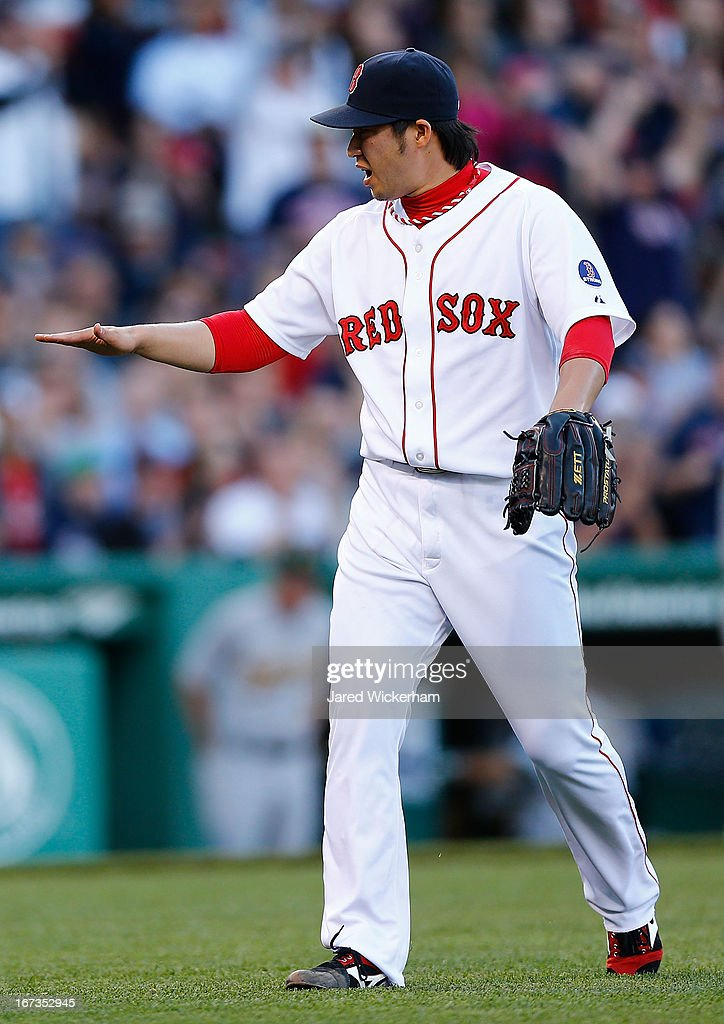 Junichi Tazawa #36 of the Boston Red Sox reacts after getting out of the inning against the Oakland Athletics during the game on April 24, 2013 at Fenway Park in Boston, Massachusetts.