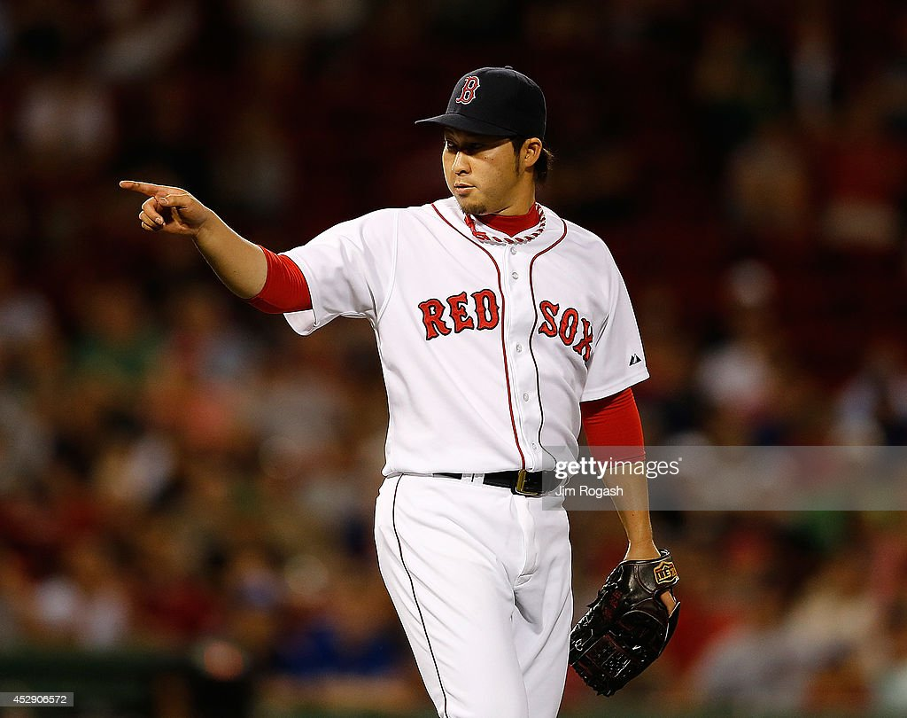 <a gi-track='captionPersonalityLinkClicked' href=/galleries/search?phrase=Junichi+Tazawa&family=editorial&specificpeople=4624306 ng-click='$event.stopPropagation()'>Junichi Tazawa</a> #36 of the Boston Red Sox reacts after getting the first out of the ninth inning against the Toronto Blue Jays at Fenway Park on July 29, 2014 in Boston, Massachusetts.