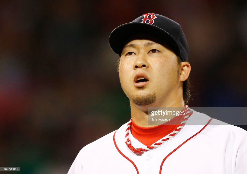 <a gi-track='captionPersonalityLinkClicked' href=/galleries/search?phrase=Junichi+Tazawa&family=editorial&specificpeople=4624306 ng-click='$event.stopPropagation()'>Junichi Tazawa</a> #36 of the Boston Red Sox reacts after giving up two runs in the eighth inning against the Los Angeles Angels at Fenway Park on August 18, 2014 in Boston, Massachusetts.