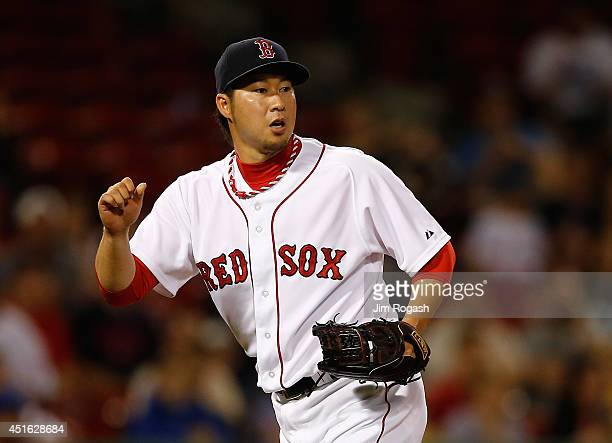 Junichi Tazawa of the Boston Red Sox reacts after he allows a run to score in the ninth inning against the Chicago Cubs at Fenway Park on July 2 2014...