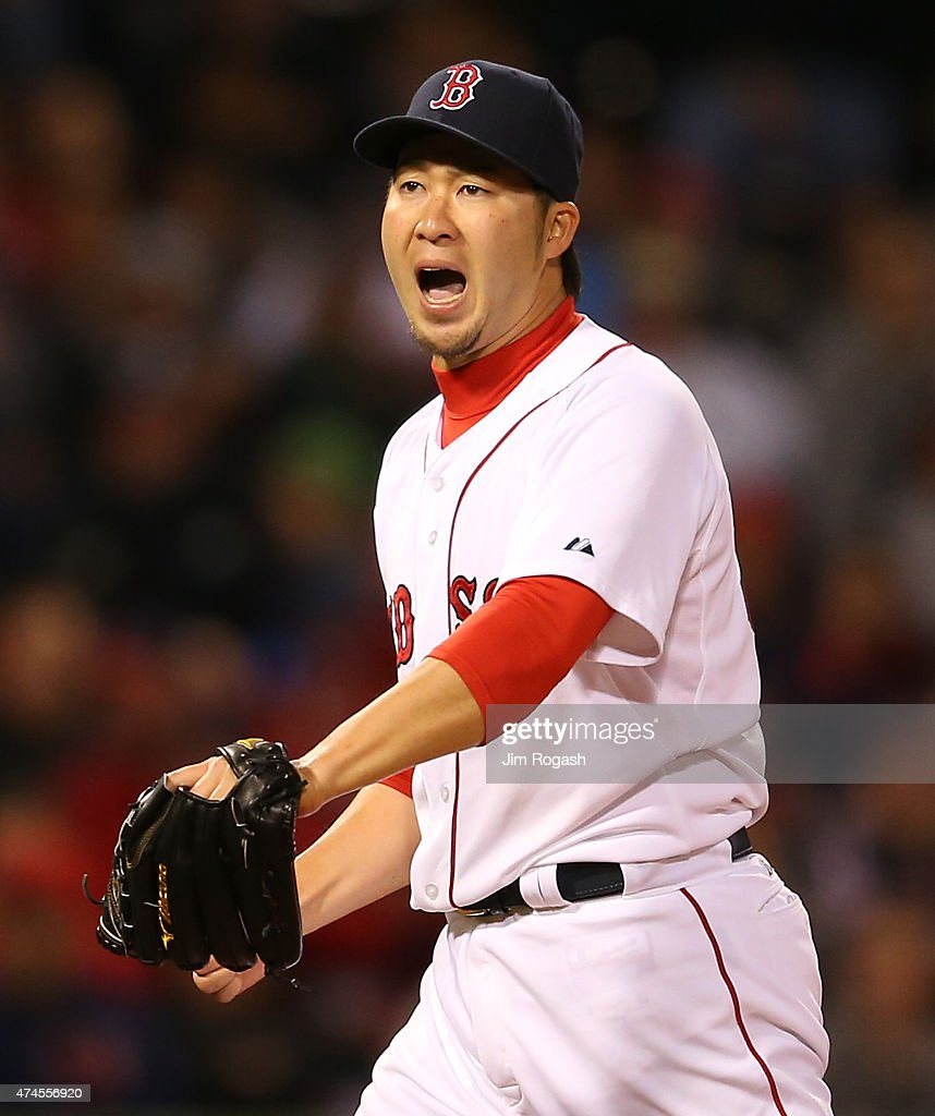 Junichi Tazawa #36 of the Boston Red Sox reacts after he pitched a scoreless eighth inning against the Los Angeles Angels at Fenway Park on May 23, 2015 in Boston, Massachusetts.