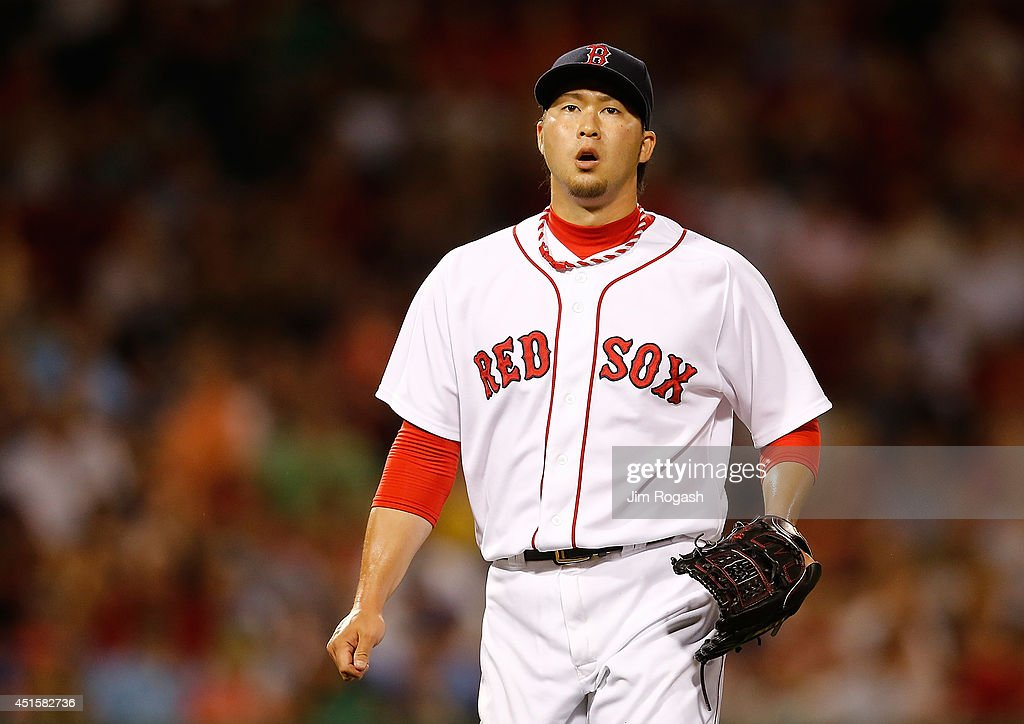 <a gi-track='captionPersonalityLinkClicked' href=/galleries/search?phrase=Junichi+Tazawa&family=editorial&specificpeople=4624306 ng-click='$event.stopPropagation()'>Junichi Tazawa</a> #36 of the Boston Red Sox reacts after throwing a scoreless eighth inning against the Chicago Cubs at Fenway Park on July 1, 2014 in Boston, Massachusetts.
