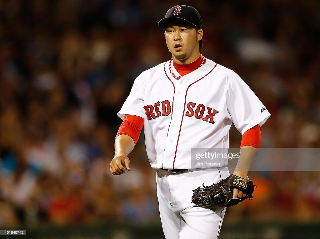 Junichi Tazawa #36 of the Boston Red Sox reacts after throwing a scoreless eighth inning against the Chicago White Sox at Fenway Park on July 9, 2014 in Boston, Massachusetts.