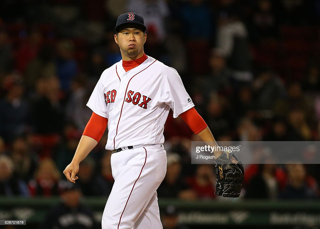 Junichi Tazawa #36 of the Boston Red Sox reacts between batters in during the ninth inning against the New York Yankees at Fenway Park on April 30, 2016 in Boston, Massachusetts.