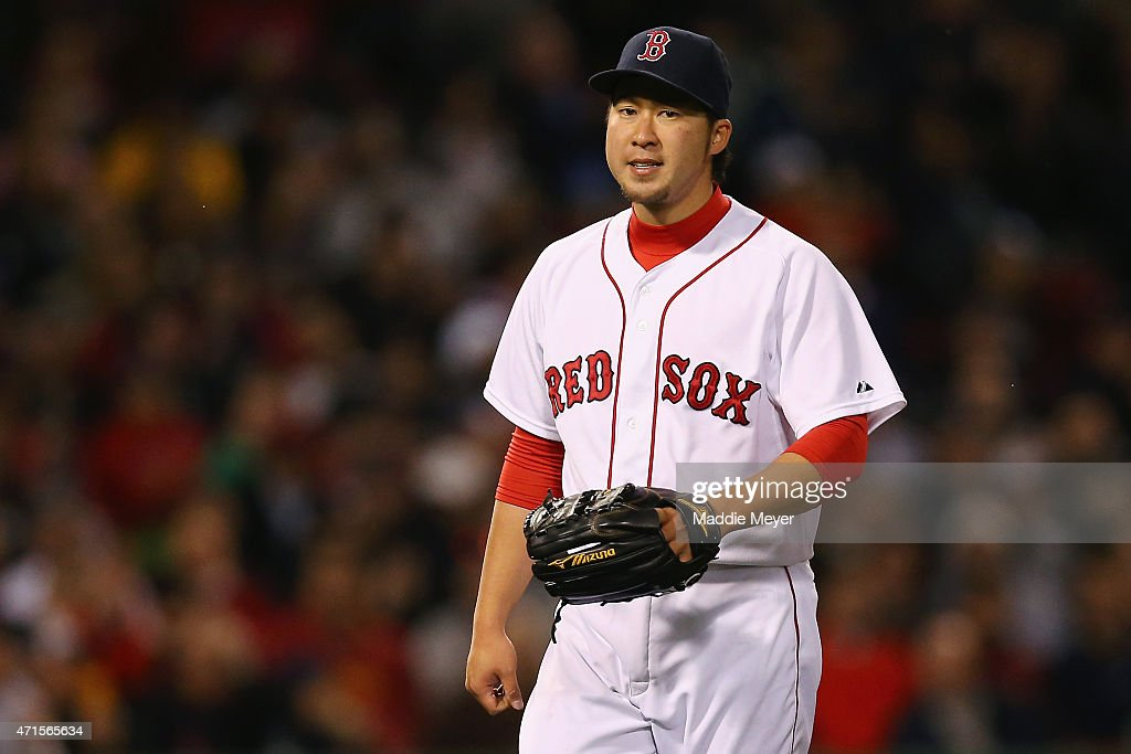Junichi Tazawa #36 of the Boston Red Sox reacts during the eighth inning against the Toronto Blue Jays at Fenway Park on April 29, 2015 in Boston, Massachusetts.