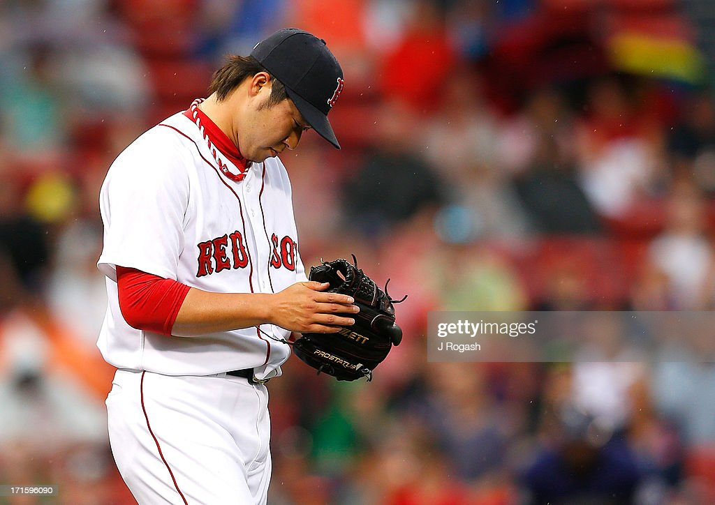 Junichi Tazawa #36 of the Boston Red Sox reacts in the 8th inning against the Colorado Rockies at Fenway Park on June 26, 2013 in Boston, Massachusetts.
