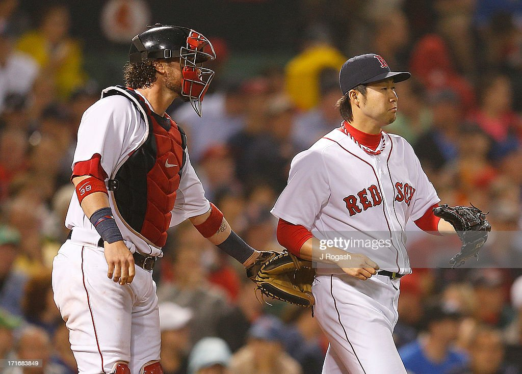 Junichi Tazawa #36 of the Boston Red Sox reacts with Jarrod Saltalamacchia #39 in the 8th inning with the bases loaded against the Toronto Blue Jays at Fenway Park on June 27, 2013 in Boston, Massachusetts.