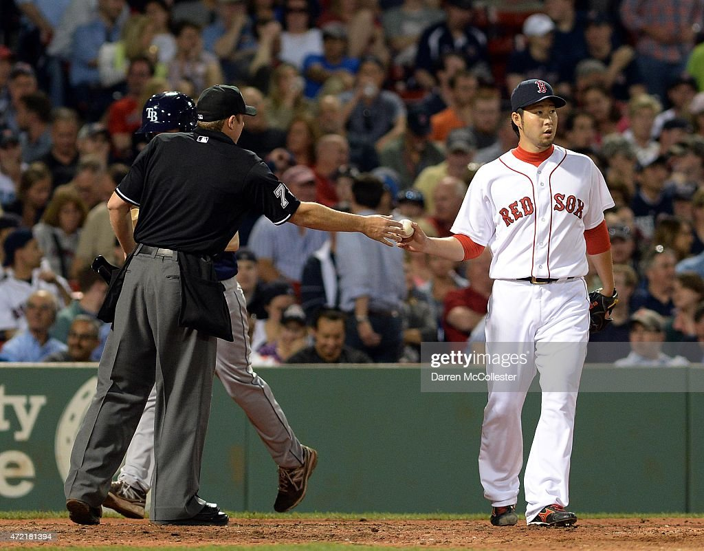 Junichi Tazawa #36 of the Boston Red Sox receives the ball back from the umpire in the top of the seventh inning against the Tampa Bay Rays at Fenway Park on May 4, 2015 in Boston, Massachusetts.