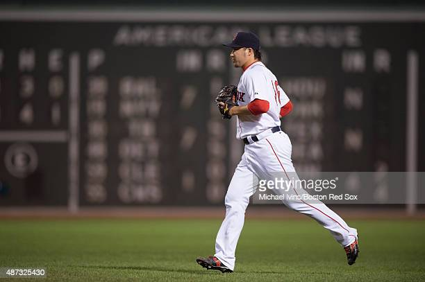 Junichi Tazawa of the Boston Red Sox runs to the mound to pitch against the Toronto Blue Jays during the eighth at Fenway Park on September 8 2015 in...