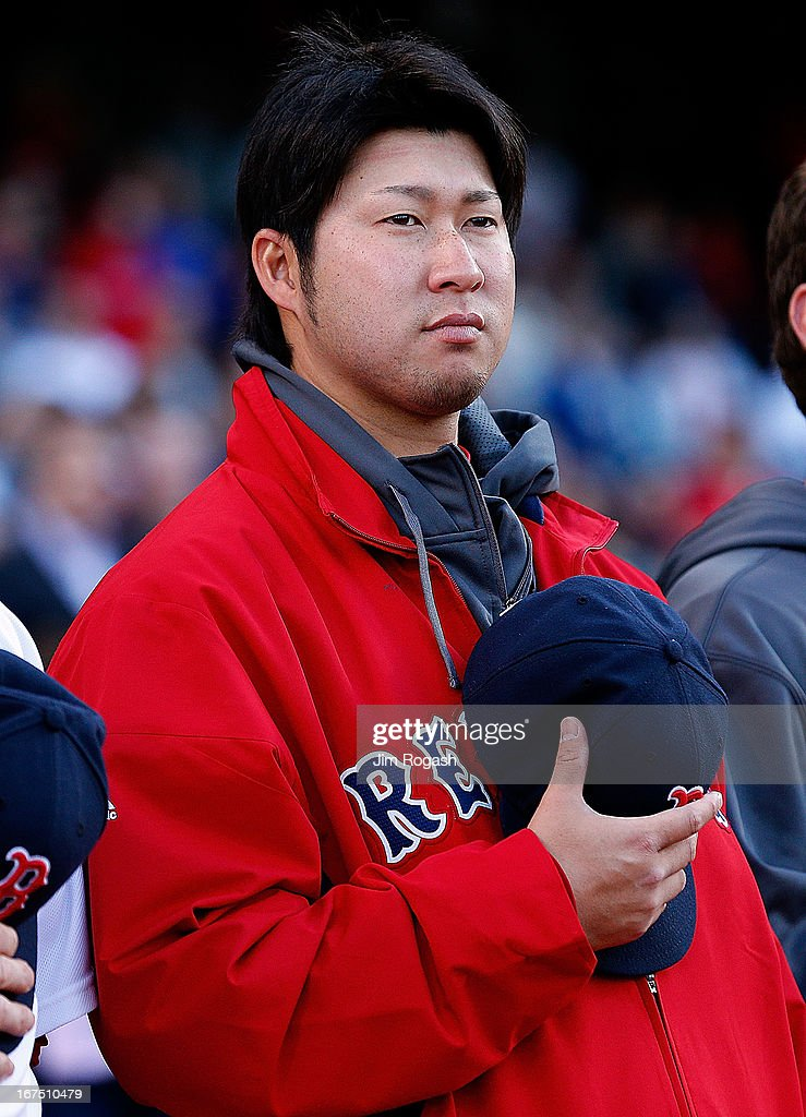Junichi Tazawa #36 of the Boston Red Sox stands during the National Anthem before a game with Houston Astros at Fenway Park on April 25, 2013 in Boston, Massachusetts.