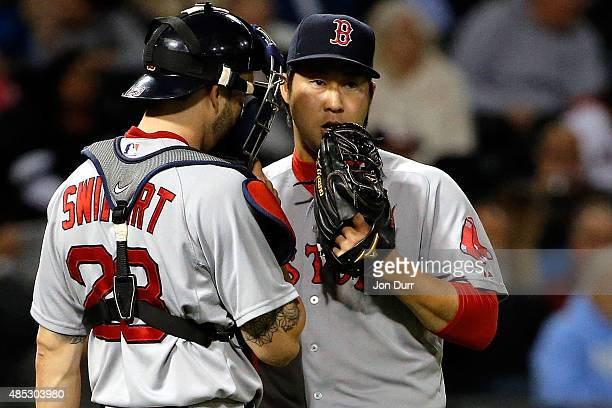 Junichi Tazawa of the Boston Red Sox talks with Blake Swihart during the ninth inning at US Cellular Field on August 26 2015 in Chicago Illinois The...