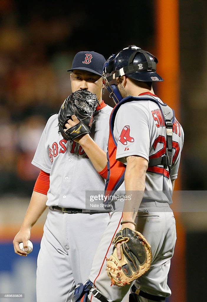 Junichi Tazawa #36 of the Boston Red Sox talks with catcher Blake Swihart #3 while pitching in the tenth inning against the New York Mets on August 28, 2015 at Citi Field in the Flushing Neighborhood of the Queens borough of New York City.