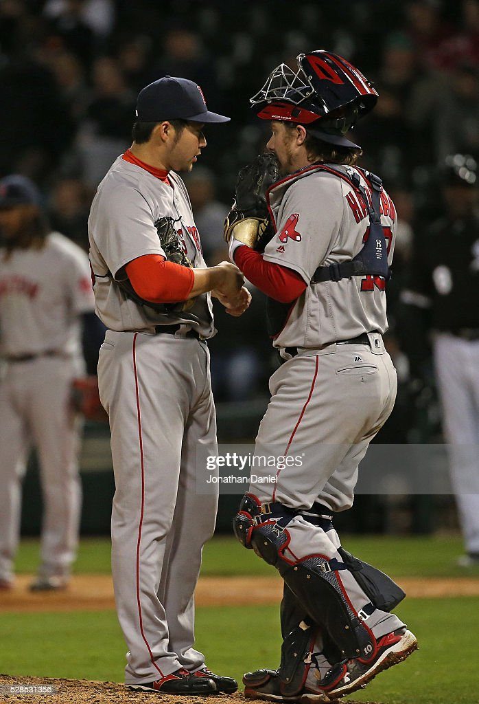 <a gi-track='captionPersonalityLinkClicked' href=/galleries/search?phrase=Junichi+Tazawa&family=editorial&specificpeople=4624306 ng-click='$event.stopPropagation()'>Junichi Tazawa</a> #36 of the Boston Red Sox talks with <a gi-track='captionPersonalityLinkClicked' href=/galleries/search?phrase=Ryan+Hanigan&family=editorial&specificpeople=833982 ng-click='$event.stopPropagation()'>Ryan Hanigan</a> #10 in the 7th inning against the Chicago White Sox at U.S. Cellular Field on May 5, 2016 in Chicago, Illinois.