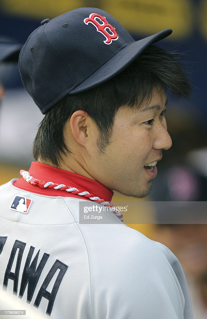 <a gi-track='captionPersonalityLinkClicked' href=/galleries/search?phrase=Junichi+Tazawa&family=editorial&specificpeople=4624306 ng-click='$event.stopPropagation()'>Junichi Tazawa</a> #36 of the Boston Red Sox talks with teammates in the dugout prior to a game against the Kansas City Royals at Kauffman Stadium August, 8, 2013 in Kansas City, Missouri.