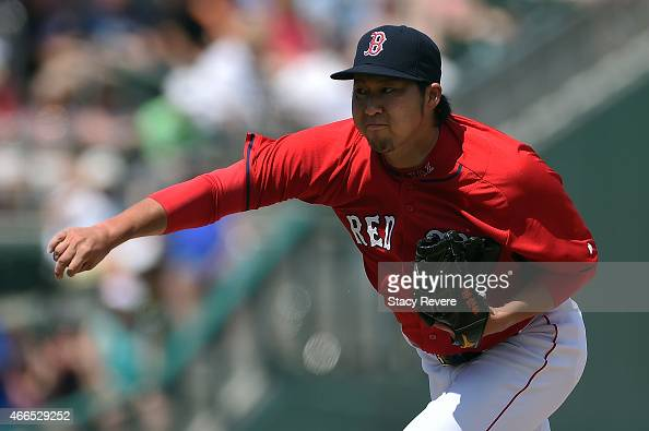 Junichi Tazawa of the Boston Red Sox throws a pitch during the fifth inning of a spring training game against the New York Mets at JetBlue Park at...