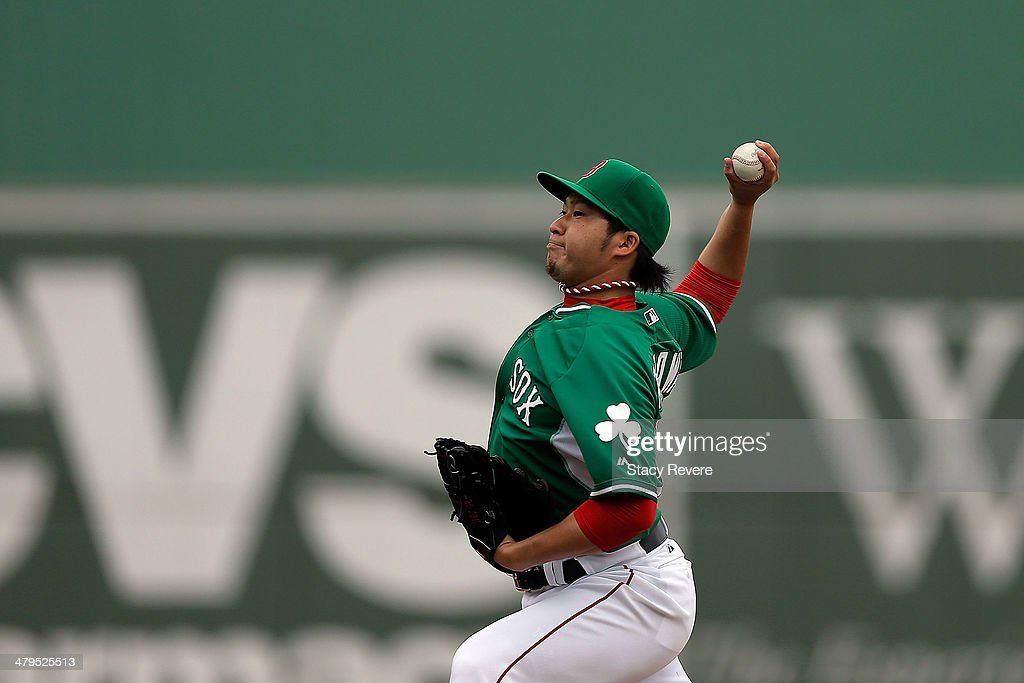 Junichi Tazawa of the Boston Red Sox throws a pitch in the ninth inning of a game against the St Louis Cardinals at JetBlue Park at Fenway South on...