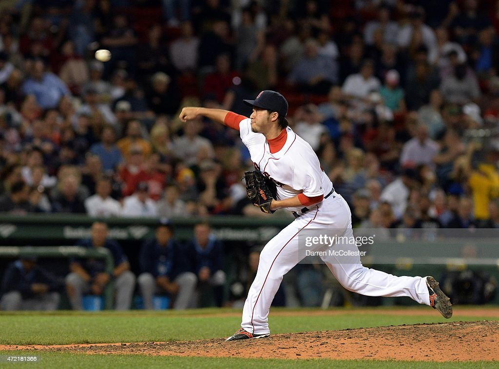 Junichi Tazawa #36 of the Boston Red Sox throws a pitch in the top of the seventh inning against the Tampa Bay Rays at Fenway Park on May 4, 2015 in Boston, Massachusetts.