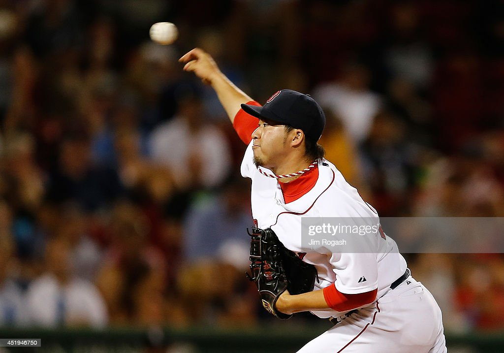 Junichi Tazawa #36 of the Boston Red Sox throws against the Chicago White Sox in the eighth inning at Fenway Park on July 9, 2014 in Boston, Massachusetts.