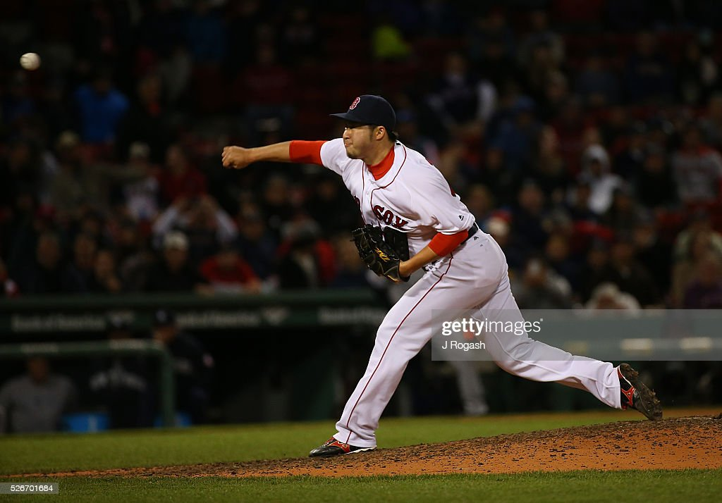 Junichi Tazawa #36 of the Boston Red Sox throws during the ninth inning against the New York Yankees at Fenway Park on April 30, 2016 in Boston, Massachusetts.