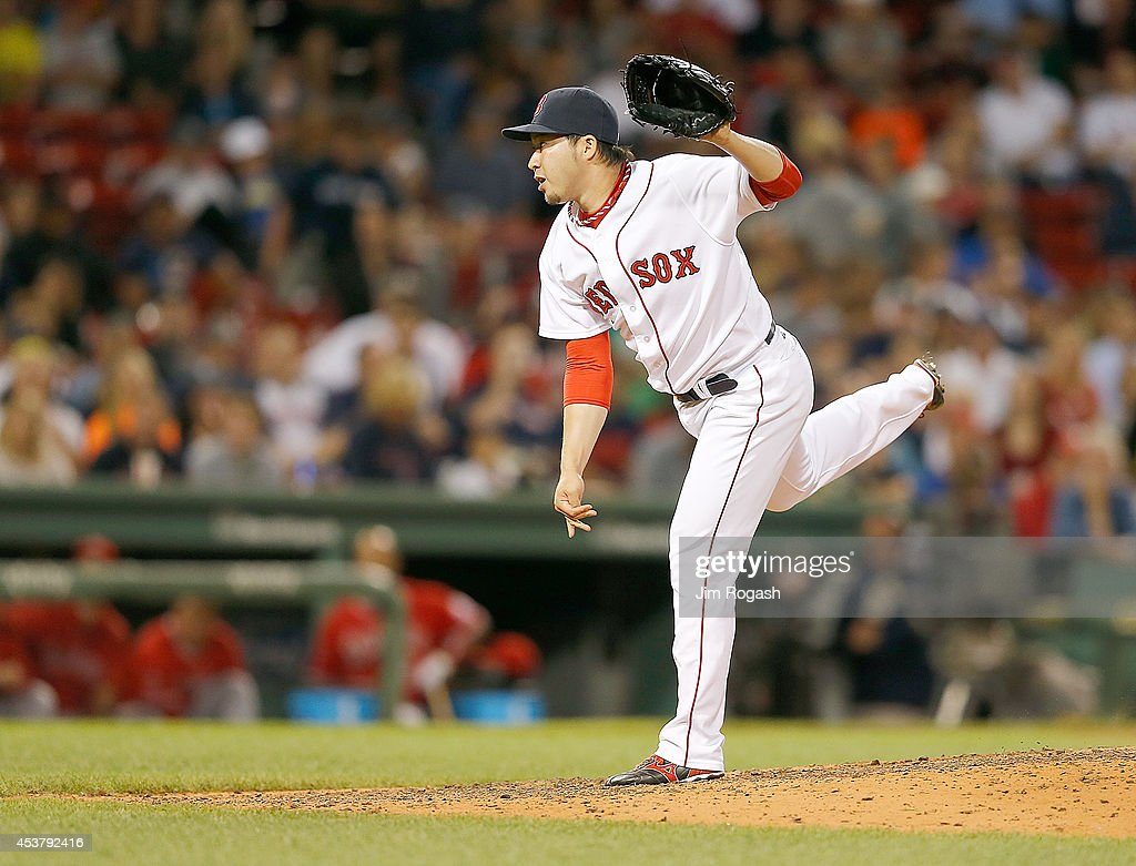 <a gi-track='captionPersonalityLinkClicked' href=/galleries/search?phrase=Junichi+Tazawa&family=editorial&specificpeople=4624306 ng-click='$event.stopPropagation()'>Junichi Tazawa</a> #36 of the Boston Red Sox throws in relief in the eighth inning against the Los Angeles Angels at Fenway Park on August 18, 2014 in Boston, Massachusetts.