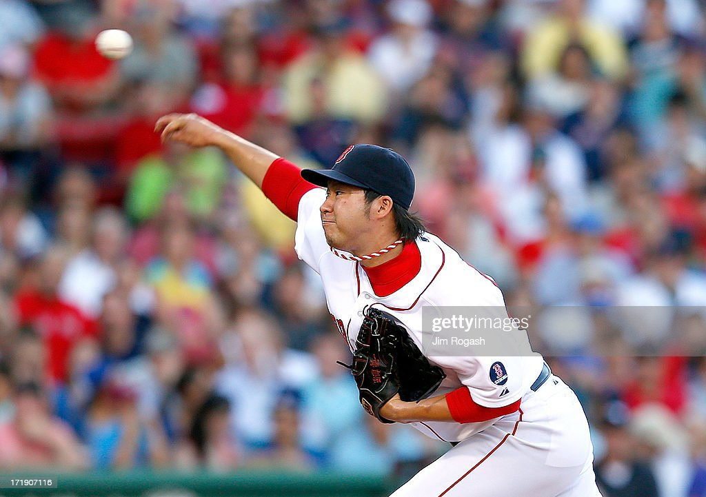 <a gi-track='captionPersonalityLinkClicked' href=/galleries/search?phrase=Junichi+Tazawa&family=editorial&specificpeople=4624306 ng-click='$event.stopPropagation()'>Junichi Tazawa</a> #36 of the Boston Red Sox throws in the 8th against the Toronto Blue Jays at Fenway Park on June 29, 2013 in Boston, Massachusetts.