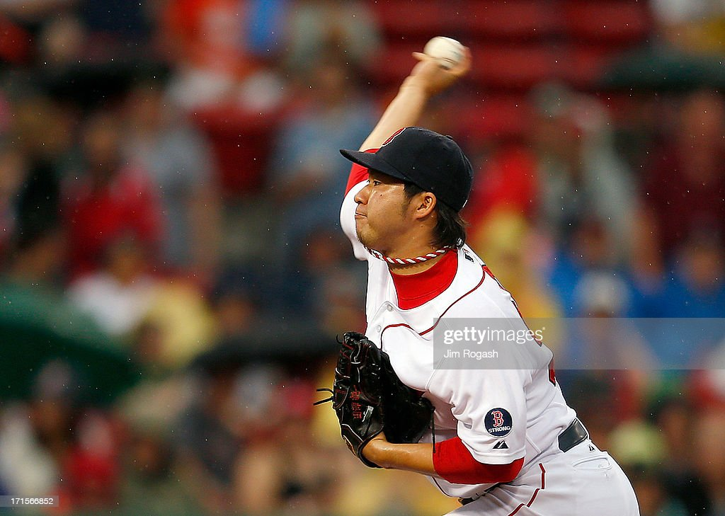 <a gi-track='captionPersonalityLinkClicked' href=/galleries/search?phrase=Junichi+Tazawa&family=editorial&specificpeople=4624306 ng-click='$event.stopPropagation()'>Junichi Tazawa</a> #36 of the Boston Red Sox throws in the 8th inning against the Colorado Rockies at Fenway Park on June 26, 2013 in Boston, Massachusetts.