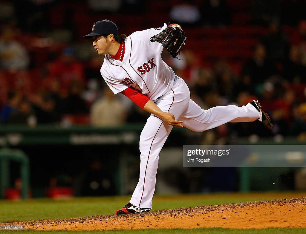 <a gi-track='captionPersonalityLinkClicked' href=/galleries/search?phrase=Junichi+Tazawa&family=editorial&specificpeople=4624306 ng-click='$event.stopPropagation()'>Junichi Tazawa</a> #36 of the Boston Red Sox throws in the 8th inning in relief against the Oakland Athletics at Fenway Park on April 22, 2013 in Boston, Massachusetts.