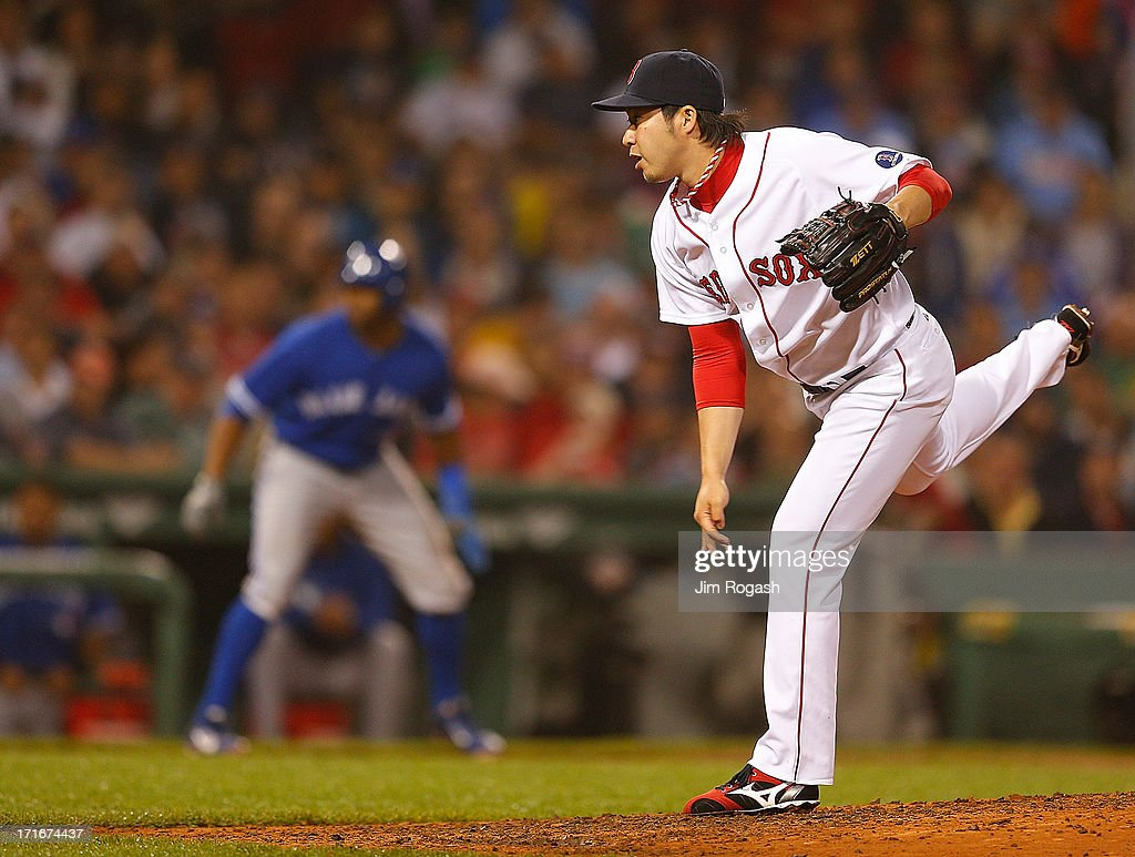<a gi-track='captionPersonalityLinkClicked' href=/galleries/search?phrase=Junichi+Tazawa&family=editorial&specificpeople=4624306 ng-click='$event.stopPropagation()'>Junichi Tazawa</a> #36 of the Boston Red Sox throws in the 8th inning with the bases loaded against the Toronto Blue Jays at Fenway Park on June 27, 2013 in Boston, Massachusetts.