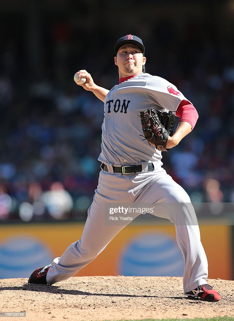 <a gi-track='captionPersonalityLinkClicked' href=/galleries/search?phrase=Junichi+Tazawa&family=editorial&specificpeople=4624306 ng-click='$event.stopPropagation()'>Junichi Tazawa</a> #36 of the Boston Red Sox throws in the eighth inning against the Texas Rangers at Rangers Ballpark in Arlington on May 5, 2013 in Arlington, Texas.