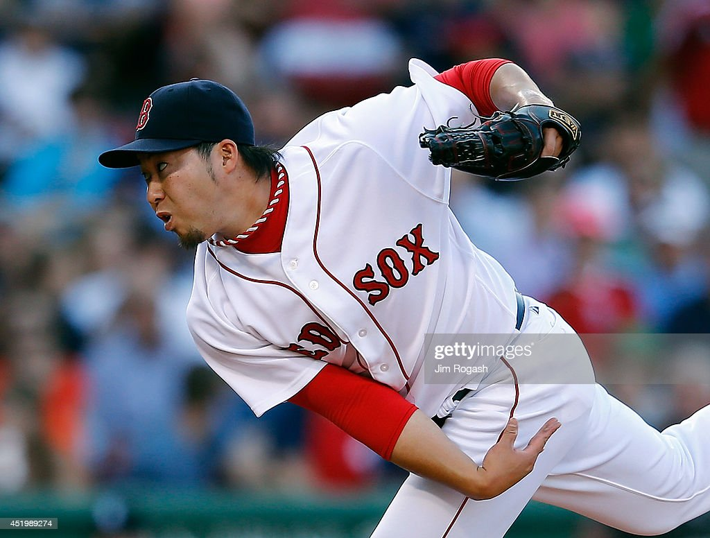 <a gi-track='captionPersonalityLinkClicked' href=/galleries/search?phrase=Junichi+Tazawa&family=editorial&specificpeople=4624306 ng-click='$event.stopPropagation()'>Junichi Tazawa</a> #36 of the Boston Red Sox throws in the eighth inning against the Chicago White Sox at Fenway Park on July 10, 2014 in Boston, Massachusetts.
