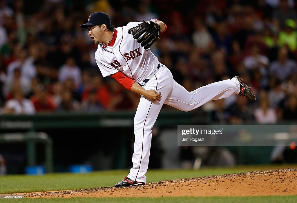 <a gi-track='captionPersonalityLinkClicked' href=/galleries/search?phrase=Junichi+Tazawa&family=editorial&specificpeople=4624306 ng-click='$event.stopPropagation()'>Junichi Tazawa</a> #36 of the Boston Red Sox throws in the eighth inning against the Los Angeles Angels of Anaheim at Fenway Park on August 21, 2014 in Boston, Massachusetts.