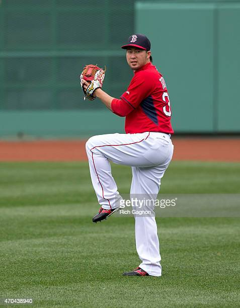 Junichi Tazawa of the Boston Red Sox throws in the outfield before a game against the Baltimore Orioles at Fenway Park on April 20 2015 in Boston...