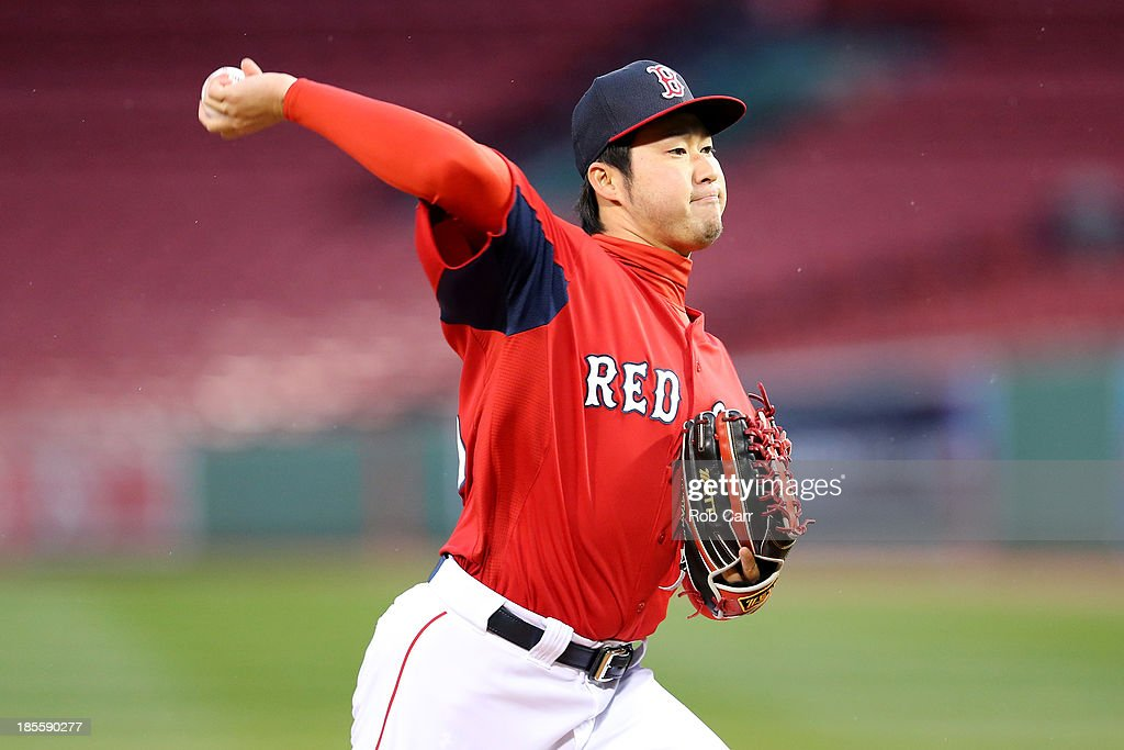 Junichi Tazawa #36 of the Boston Red Sox throws the ball during team workout in the 2013 World Series Media Day at Fenway Park on October 22, 2013 in Boston, Massachusetts. The Red Sox host the Cardinals in Game 1 on October 23, 2013.