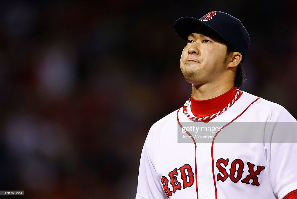 <a gi-track='captionPersonalityLinkClicked' href=/galleries/search?phrase=Junichi+Tazawa&family=editorial&specificpeople=4624306 ng-click='$event.stopPropagation()'>Junichi Tazawa</a> #36 of the Boston Red Sox walks back to the dugout after pitching against the New York Yankees during the game on August 18, 2013 at Fenway Park in Boston, Massachusetts.
