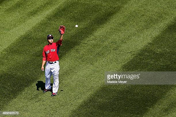 Junichi Tazawa of the Boston Red Sox warms up before the game against the Washington Nationals at Fenway Park on April 13 2015 in Boston Massachusetts
