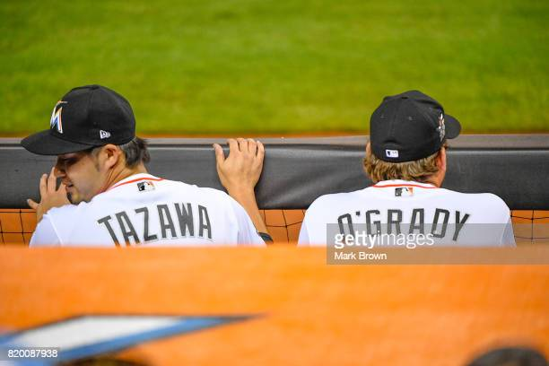 Junichi Tazawa of the Miami Marlins and Chris O'Grady in action during the game between the Miami Marlins and the Los Angeles Dodgers at Marlins Park...