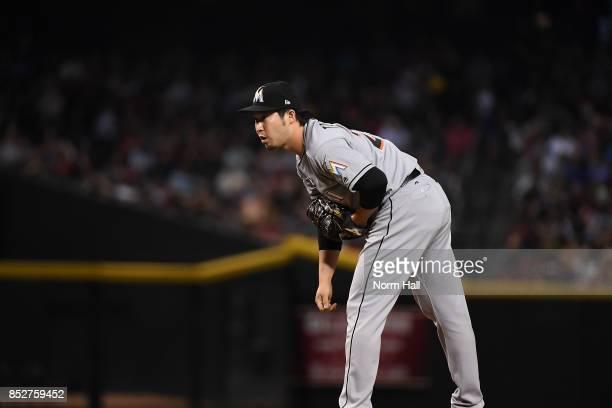 Junichi Tazawa of the Miami Marlins delivers a pitch against the Arizona Diamondbacks at Chase Field on September 22 2017 in Phoenix Arizona