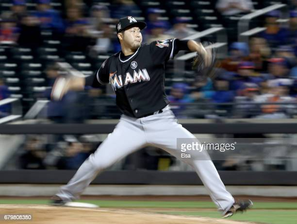 Junichi Tazawa of the Miami Marlins delivers a pitch in the eighth inning against the New York Mets on May 6 2017 at Citi Field in the Flushing...