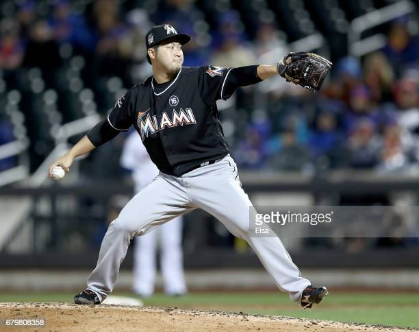 Junichi Tazawa of the Miami Marlins delivers a pitch in the seventh inning against the New York Mets on May 6 2017 at Citi Field in the Flushing...